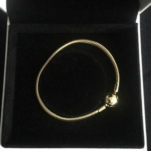 Golden Pandora bracelet. Brand New.